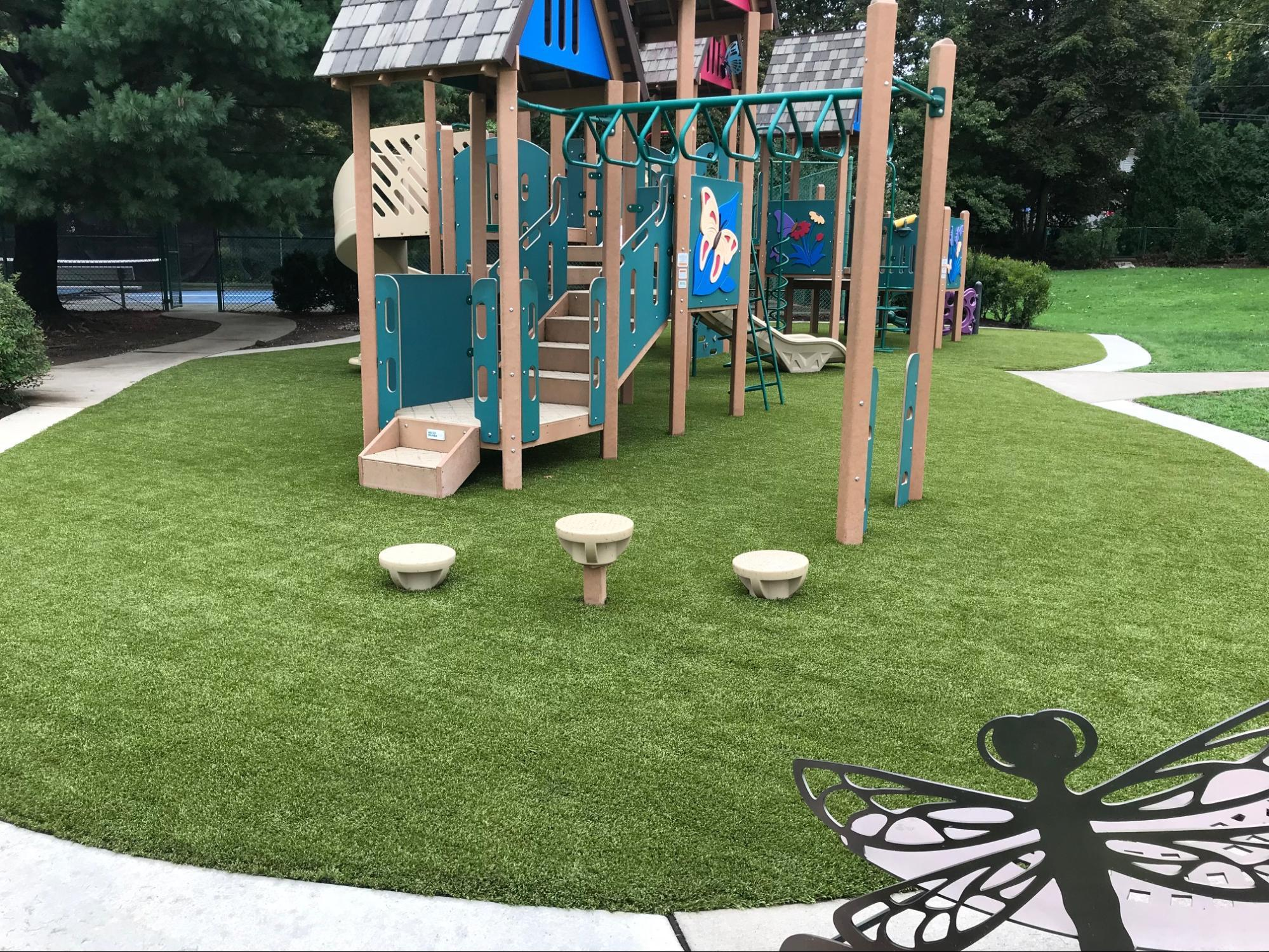 Bug-themed playground at the Laurel School in Shaker Heights, Ohio, featuring Playground Grass Ultra by ForeverLawn